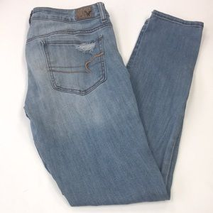 Light wash lightly ripped skinny jeans